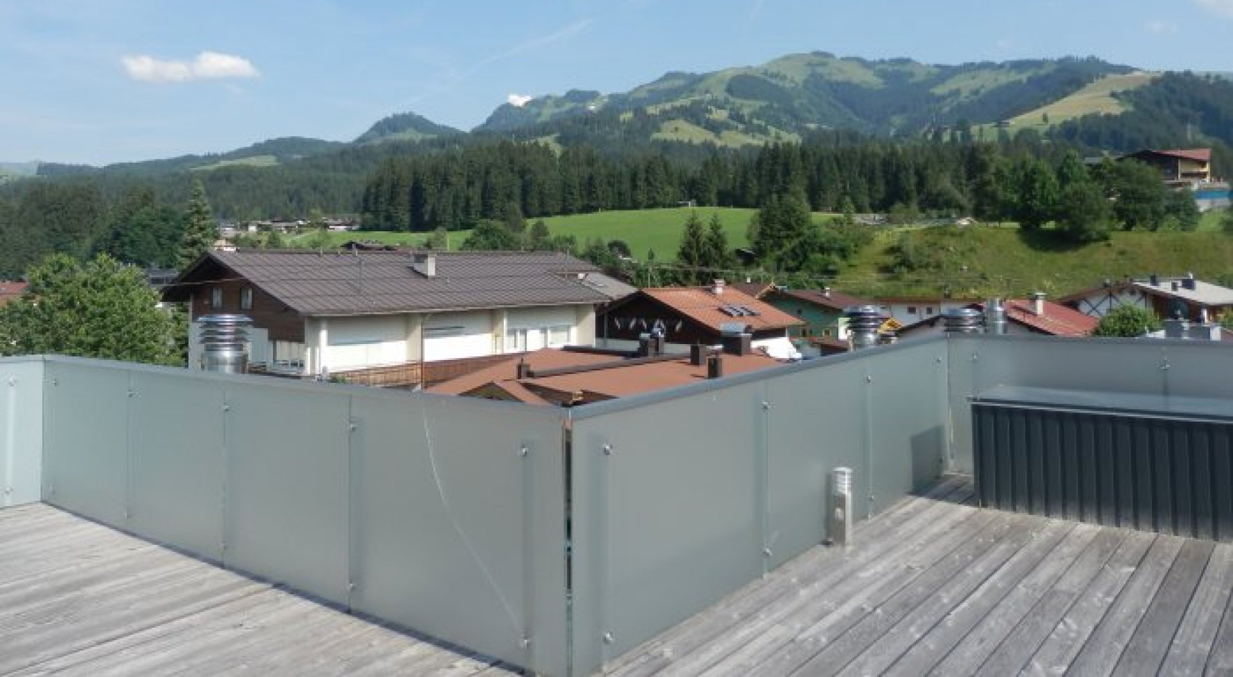 Property in 6365  Kirchberg: rooftop terrace jewel with a lift directly to the apartment - picture 1